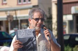 Michael Hawkeye Herman with Dick Waterman's book