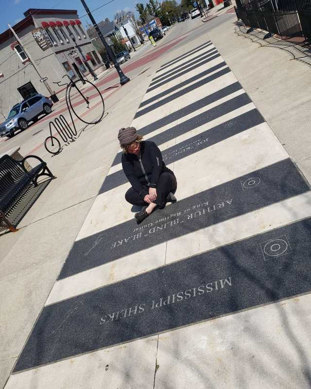 Angie Mack Reilly sits on the Paramount Walk of Fame